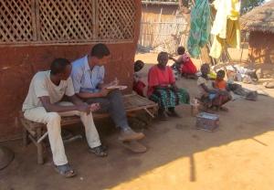 Dereje conducts survey in refugee camp.