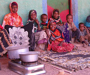Somali refugee family cooks with CleanCook ethanol stove.